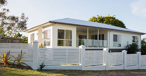 White Vinyl Fence around Home